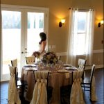WildRoseEvents-Elegant-table-setting-at-the-Castle-at-Rockwall-with-beautiful-laced-chivari-chairs-and-hydrangea-centerpiece