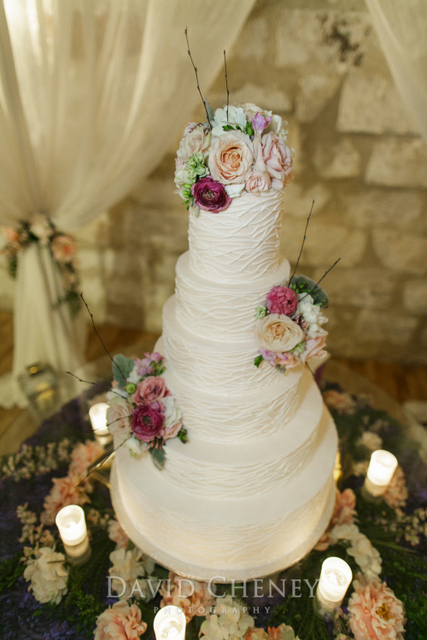 WildRoseEvents-Poetry-springs-Events-table-display-and-cake-flowers-with-fabric-draping-flowers-under-glass-top-down-2