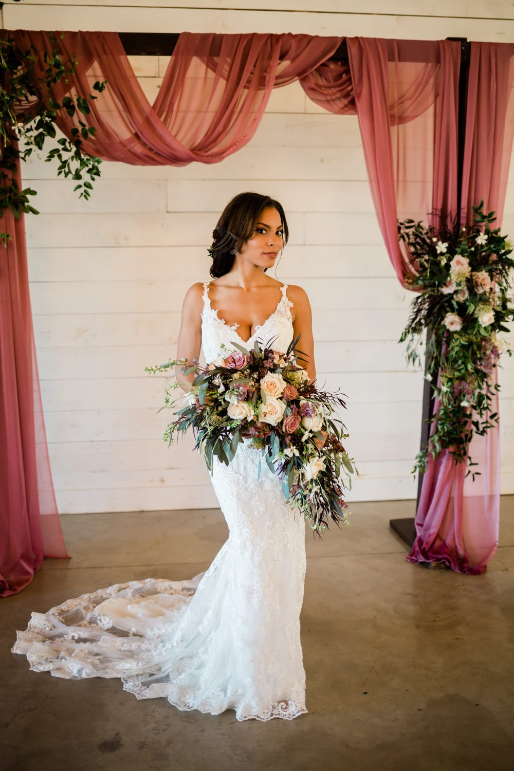 Wild Rose Events Dallas Wedding Florist at Dallas Wedding Venue Under the Wildwood by Drawing with Light Photography, boho wedding bouquet and wedding arch