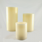 Trio of white pillar candles, small medium and large.